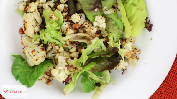 Add some low carb crunch and flavor to your salad with roasted cauliflower! This WLS friendly side dish is perfect to pair with lean protein like chicken, beef, fish or pork! Bariatric surgery patients you will love this easy but fun side salad! #wls #wlsrecipes #gastricsleeve #gastricbypass #bariatric