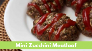 Individual sized meatloaf with grated zucchini ground beef and ketchup on top