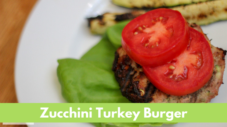 Zucchini Turkey Burger with grated zucchini and ground turkey over lettuce topped with tomato slices