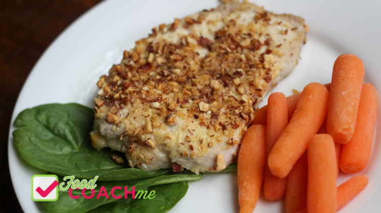 Pork chops coated with parmesan cheese, dijon mustard and chopped almonds with steamed carrots
