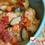 Chicken with zucchini, carrots, onion and tomatoes for a chicken cacciatore or hunters stew