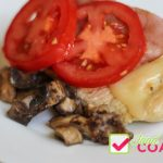 Chicken breast topped with swiss cheese, pan fried ham slice, tomatoes and sautéed mushrooms