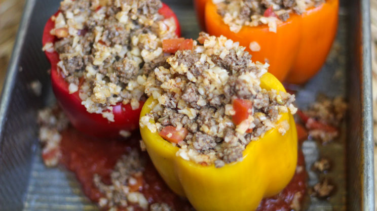 Stuffed peppers with lean ground beef and cauliflower rice with salsa tomatoes taco seasoning and cumin