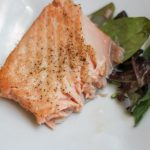Flakey fresh salmon on a white plate made in air fryer for bariatric friendly recipe