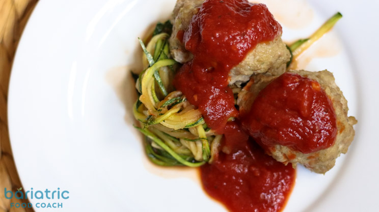 Ground Turkey with fresh Pesto and grated parmesan cheese baked meatballs with marinara sauce and zucchini noodles from Bariatric Food Coach